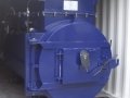 Surefire SF50kg ph Clinical-General Waste Incinerator with large secondary chamber - installed in a shipping container